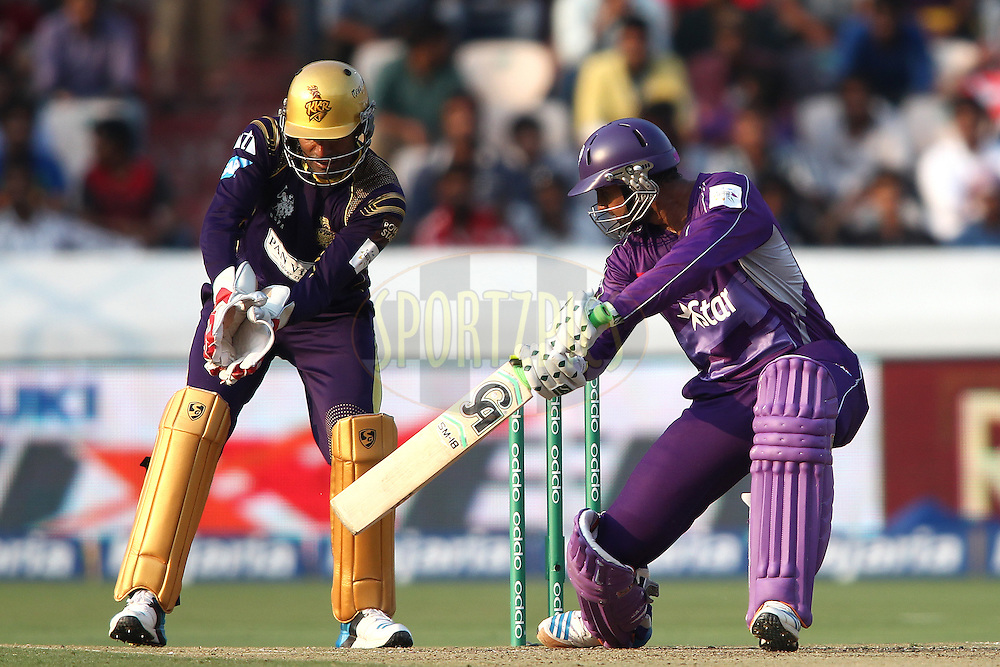 Shoaib Malik of the Hobart Hurricanes plays a delivery behind square during the first semi final match of the Oppo Champions League Twenty20 between the Kolkata Knight Riders and the Hobart Hurricanes held at the Rajiv Gandhi Cricket Stadium, Hyderabad, India on the 2nd October 2014<br /> <br /> Photo by:  Shaun Roy / Sportzpics/ CLT20<br /> <br /> <br /> Image use is subject to the terms and conditions as laid out by the BCCI/ CLT20.  The terms and conditions can be downloaded here:<br /> <br /> http://sportzpics.photoshelter.com/gallery/CLT20-Image-Terms-and-Conditions-2014/G0000IfNJn535VPU/C0000QhhKadWcjYs