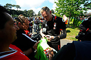 AFC Bournemouth goalkeeper Ryan Allsop signing his autograph for a fan on arrival for the Premier League match between Bournemouth and Burnley at the Vitality Stadium, Bournemouth, England on 13 May 2017. Photo by Graham Hunt.