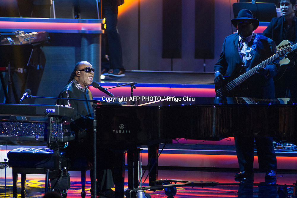 Honoree Stevie Wonder performs during the finale of the concert, Stevie Wonder: Songs In The Key Of Life - An All-Star GRAMMY Salute, at Nokia Theatre L.A. Live on February 10, 2015 in Los Angeles, California. AFP PHOTO / Ringo Chiu