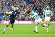 Sean Maitland pre-empts a tackle during the Autumn Test match between Scotland and Argentina at Murrayfield, Edinburgh, Scotland on 24 November 2018.