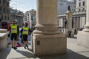 City Police officers make their presence known while on their horses in spring sunshine at Royal Exchange in the heart of the capital's financial district, on 19th April, in the City of London, England.