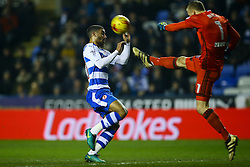 Daniel Bentley of Brentford clears the ball under pressure from Lewis Grabban of Reading - Mandatory by-line: Jason Brown/JMP - 14/02/2017 - FOOTBALL - Madejski Stadium - Reading, England - Reading v Brentford - Sky Bet Championship