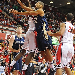 Notre Dame Fighting Irish guard Joey Brooks (32) sneaks a layup behind Rutgers Scarlet Knights guard/forward Dane Miller's (11) attempted block during Big East NCAA action during Rutgers' 65-58 victory over Notre Dame at the Louis Brown Athletic Center in Piscataway, N.J.
