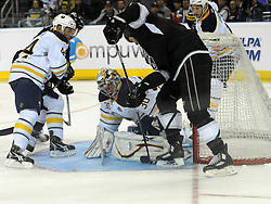 08.10.2011, O2 World, Berlin, Linz, GER, NHL, Buffalo Sabres vs LA Kings, im Bild Goalkeeper Ryan Miller (Buffalo Sabres, #30) with a save on Kevin Westgarth (LA Kings, #19), during the Compuware NHL Premiere, O2 World Berlin, Berlin, Germany, 2011-10-08, EXPA Pictures © 2011, PhotoCredit: EXPA/ Reinhard Eisenbauer