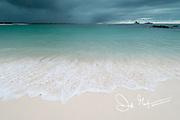 Dark clouds over Cerro Brujo beach on San Cristobal Island in the Galapagos archipelago of Ecuador.