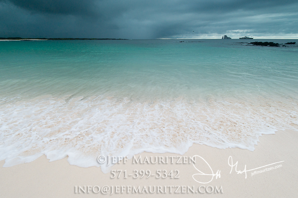 Dark clouds over Cerro Brujo beach on San Cristobal Island in the Galapagos archipelago of Ecuador.