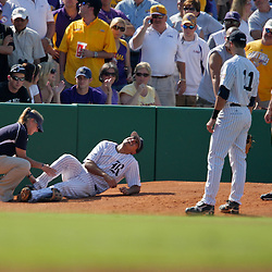 06 June 2009:  A trainer tends to injured third baseman Anthony Rendon (23) in the top of the second inning, during game two of the NCAA baseball Super Regional between the Rice Owls and the LSU Tigers at Alex Box Stadium in Baton Rouge, Louisiana.
