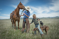 """The J Bar L ranch is a unique, conservation-friendly ranch nestled into the wide open land of the Centennial Valley in southern Montana. Now, spurred by growing consumer concern over meat's environmental impact and concerned about the long-term viability of their livelihood, a cohort of ranchers is trying to apply the understanding gleaned from the science of ecology to livestock management. The J Bar L ranch finishes their cattle on grass, in contrast to the vast majority of ranches in the U.S. that send cattle to feedlots. The 2,000 head at J Bar L """"never go into a feedlot,"""" said Bryan Ulring, manager of the ranch. He added that the J Bar L is one of the biggest grass finishers in the state. The Centennial Valley is an important wildlife corridor for elk, moose, antelope, deer, wolverines, grizzly bears, wolves and hundreds of bird species. The valley is largely owned by a handful of large ranches, which means their use of the land impacts the local environment. © Ami Vitale"""