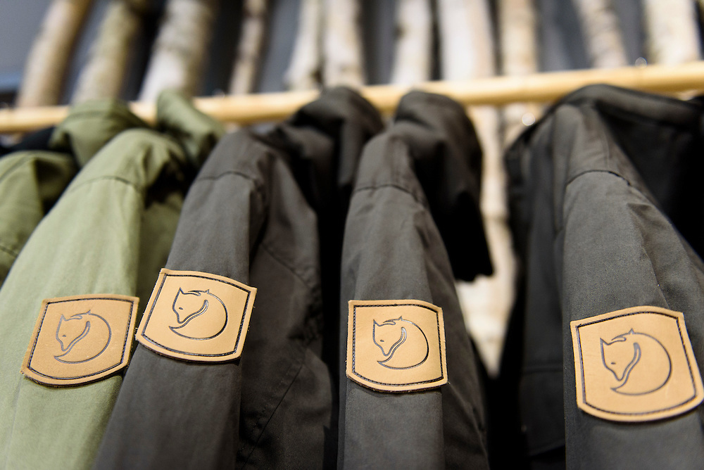 Guests mingle and look at clothing apparel and outdoor-outfitter gear during a grand opening event for Fjällräven Madison, a Swedish-heritage brand store in downtown Madison, Wis., on Oct. 22, 2015. (Photo by Jeff Miller - www.jeffmillerphotography.com)