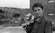 Boy with cans, High Wycombe, UK, 1980s.