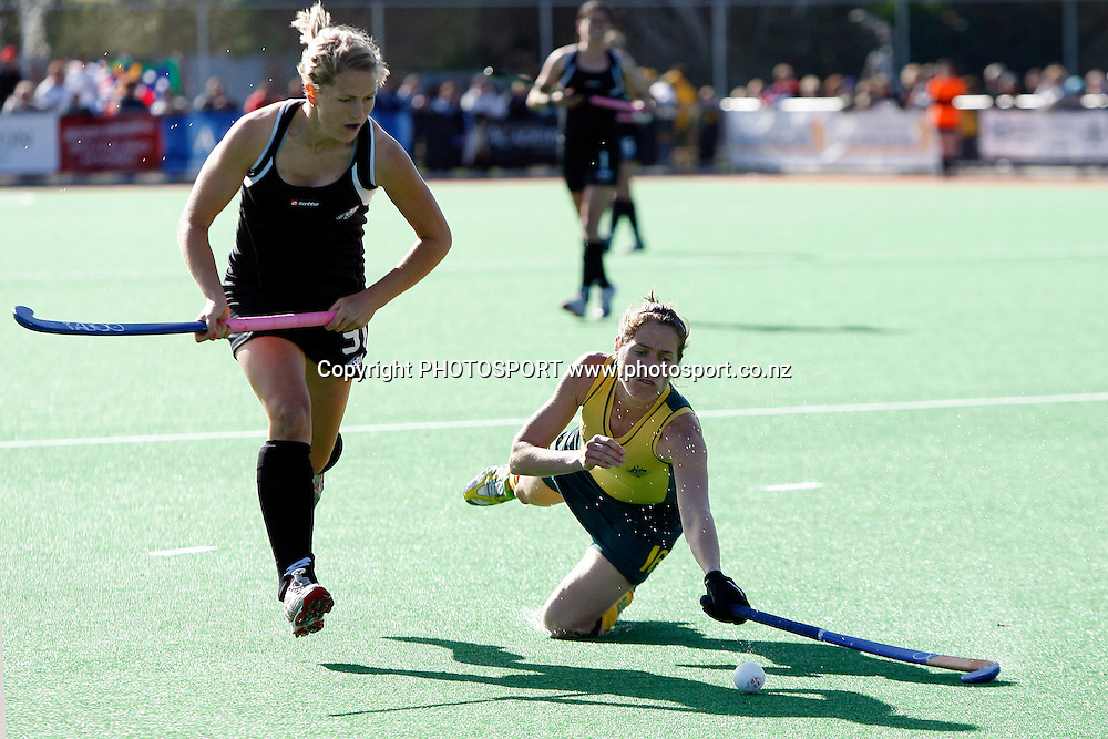 New Zealand's Stacey Michelsen on the attack as Australia's Fiona Johnson dives for the ball.<br />