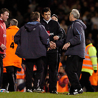 Photo: Leigh Quinnell.<br /> West Ham United v Fulham. The Barclays Premiership. 13/01/2007. Fulham manager Chris Coleman chats West Manager Alan Curbishley and his team after the game.