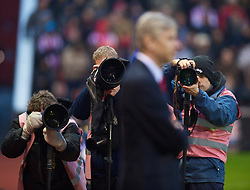 STOKE-ON-TRENT, ENGLAND - Saturday, February 27, 2010: Photographers focus on Arsenal's manager Arsene Wenger before the FA Premier League match against Stoke City at the Britannia Stadium. (Photo by David Rawcliffe/Propaganda)