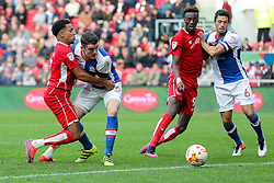 Korey Smith of Bristol City is held back by Darragh Lenihan of Blackburn Rovers as Tammy Abraham of Bristol City and Jason Lowe of Blackburn Rovers compete - Rogan Thomson/JMP - 22/10/2016 - FOOTBALL - Ashton Gate Stadium - Bristol, England - Bristol City v Blackburn Rovers - Sky Bet EFL Championship.