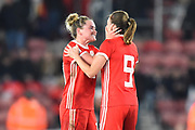 Rachel Rowe (13) of Wales and Kayleigh Green (9) of Wales celebrate at full time after Wales held England to a 0-0 draw during the FIFA Women's World Cup UEFA Qualifier match between England Ladies and Wales Women at the St Mary's Stadium, Southampton, England on 6 April 2018. Picture by Graham Hunt.