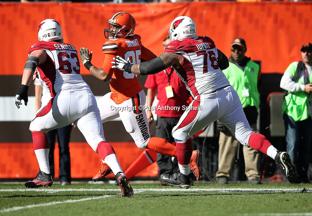 Cleveland Browns outside linebacker Armonty Bryant (95) tries to outrun Arizona Cardinals guard Mike Iupati (76) and Arizona Cardinals center Lyle Sendlein (63) down the sideline as he returns a first quarter fumble recovery to the Arizona Cardinals 9 yard line during the 2015 week 8 regular season NFL football game against the Arizona Cardinals on Sunday, Nov. 1, 2015 in Cleveland. The Cardinals won the game 34-20. (©Paul Anthony Spinelli)