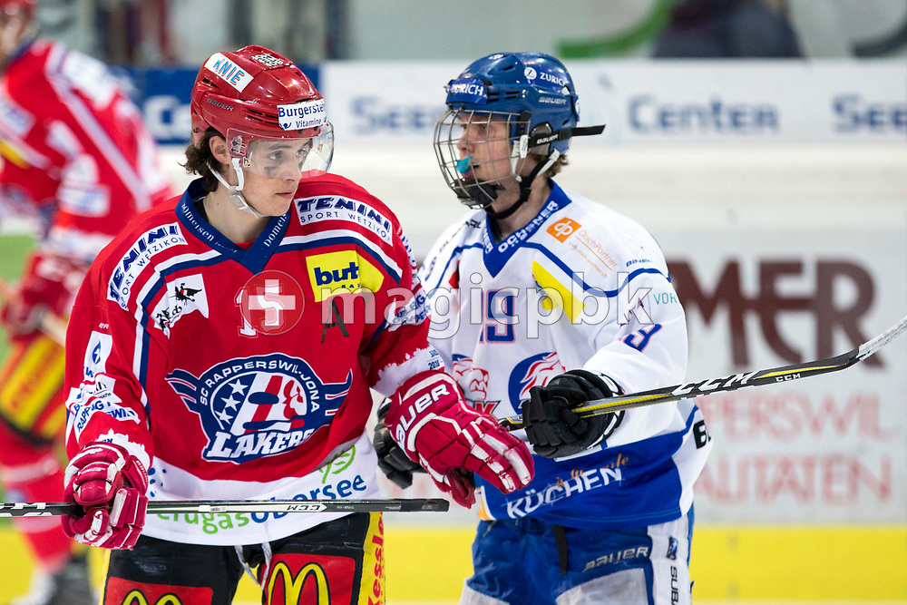 (L-R) Rapperswil-Jona Lakers forward Manuel Laimbacher and ZSC Lions forward Dimitry Mokry are pictured during the fifth Elite B Playoff Final ice hockey game between Rapperswil-Jona Lakers and ZSC Lions held at the SGKB Arena in Rapperswil, Switzerland, Sunday, Mar. 19, 2017. (Photo by Patrick B. Kraemer / MAGICPBK)