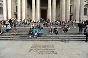 35559258© Licensed to London News Pictures. 28/10/2011. London, UK. People sit on the steps during a Eucharist service held at St Paul's Cathedral today. St Paul's Cathedral reopened its doors at midday today. The Cathedral had been closed over health and safety fears from the Occupy London protest outside.  Photo: Stephen Simpson/LNP