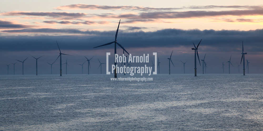 © Rob Arnold.  01/04/2014. North Wales, UK. Dawn on the Gwynt y Môr Offshore Wind Farm off the coast of North Wales. Photo credit : Rob Arnold