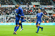 Jorginho (#5) of Chelsea celebrates with Olivier Giroud (#18) of Chelsea following Chelsea's second goal, an own goal scored by DeAndre Yedlin (#22) of Newcastle United during the Premier League match between Newcastle United and Chelsea at St. James's Park, Newcastle, England on 26 August 2018.
