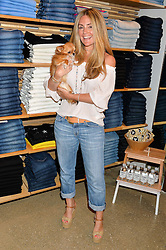 DONNA IDA THORNTON and her dog Fernando at a party to celebrate the paperback lauch of The Stylist by Rosie Nixon hosted by Donna Ida at her store at 106 Draycott Avenue, London on 17th August 2016.
