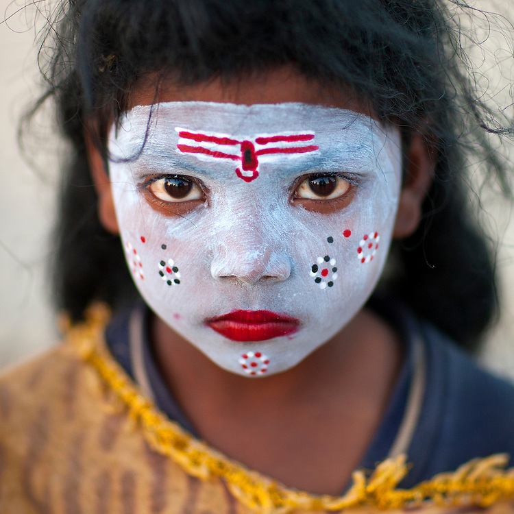 Young girl with Shiva make up. Maha Kumbh Mela festival, world's largest congregation of religious pilgrims. Allahabad, India.