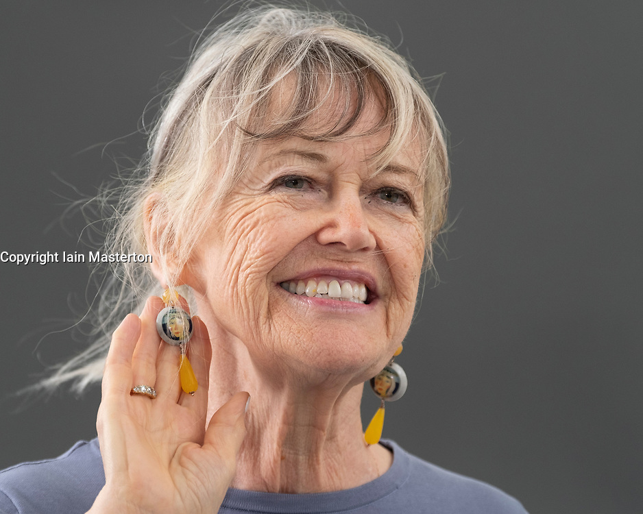 "Edinburgh, Scotland, UK; 17 August, 2018. Pictured; Helen Bellany, ( displaying earrings using her husband's paintings) widow of artist John Bellany, talks about the mystery, poetry and passion that was at the core of their life together in  her book ""The Restless Wave""."