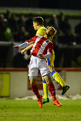 STOCKPORTS SCOTT DUXBERRY HOLDS OF BRACKLEYS ELLIS MYLES, Brackley Town v Stockport County, Buildbase FA Trophy 4th Round Replay, Tuesday 6th March 2018 Score 2-1 <br /> Photo:Mike Capps