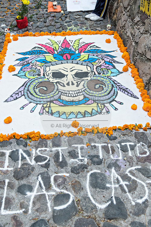 A Dead of the Dead sand painting on display outside the San Juan de Dios Church during the Dia de Muertos festival in San Miguel de Allende, Mexico. The multi-day festival is to remember friends and family members who have died using calaveras, aztec marigolds, alfeniques, papel picado and the favorite foods and beverages of the departed.