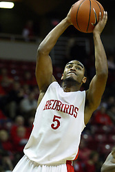 29 December 2010: Anthony Cousin holds on tight as he goes inside and hard to the hoop during an NCAA basketball game where the Creighton Bluejays defeated the Illinois State Redbirds at Redbird Arena in Normal Illinois.