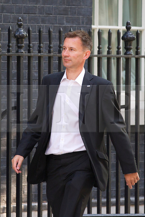 "© Licensed to London News Pictures. 29/08/2013. London, UK. The Health Secretary Jeremy Hunt arrives for a meeting of the British cabinet on Downing Street in London today (29/08/2013) as a recalled British Parliament prepares to debate the possibility of ""direct"" military action over recent reports an alleged chemical weapons attack in Syria. Photo credit: Matt Cetti-Roberts/LNP"