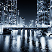 Chicago River at State Street Bridge (Bataan-Corregidor Memorial Bridge) at night along the Chicago River with the Leo Burnett Building, United Airlines Building, 55 West Wacker, and Marina City Towers