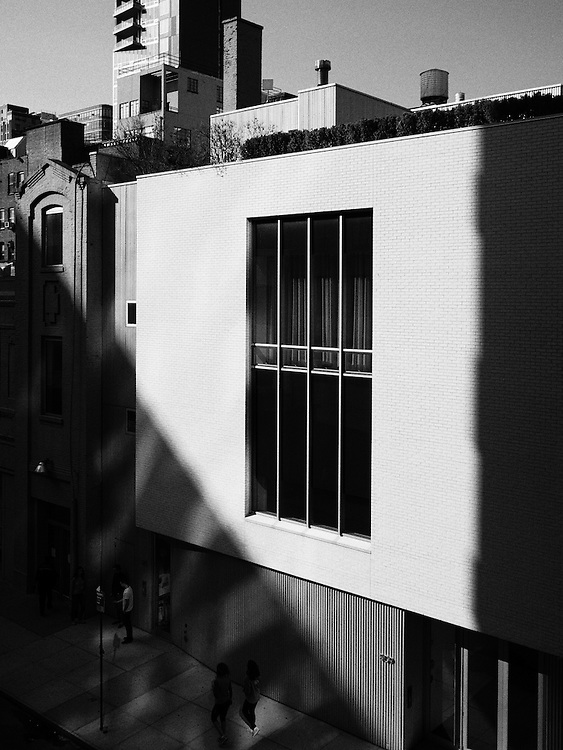 A window is seen from the High Line Park.  An image from S. R. Shilling II's photographic series documenting his experience observing United State's largest city, New York.