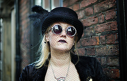 © Licensed to London News Pictures. <br /> 01/11/2014. <br /> <br /> Whitby, Yorkshire, United Kingdom<br /> <br /> Lisa Metcalf from Halifax poses for a picture during the Whitby Goth Weekend. <br /> <br /> The event this weekend brings together thousands of extravagantly dressed followers of Victoriana, Steampunk, Cybergoth and Romanticism who all visit the town to take part in celebrating Gothic culture. This weekend marks the 20th anniversary since the event was started by local woman Jo Hampshire.<br /> <br /> Photo credit : Ian Forsyth/LNP