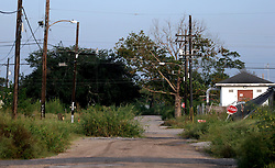 29 August 2007. Lower 9th Ward, New Orleans, Louisiana. <br /> Second anniversary of Hurricane Katrina. The empty streets of the largely derelict and decimated Lower 9th Ward. The area remains mostly abandoned and overgrown, ghostly reminders of lives that once were. President Bush came to town and claimed he could be proud of what local and federal government have achieved in the city. Yet two years after the storm, it is quite clear that local and federal government are failing and have a great deal to do to live up their promises.<br /> Photo credit©; Charlie Varley/varleypix.com