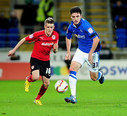 Cardiff City's Graig Noone  and Peterborough United's George Thorne battle for possession - Photo mandatory by-line: Dougie Allward/JMP  - Tel: Mobile:07966 386802 15/12/2012 - SPORT - FOOTBALL -  Championship -  Cardiff-  New Cardiff City Stadium  -  Cardiff City v Peterborough United