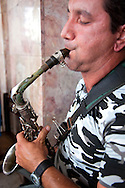 Sax player in Cueto, Holguin, Cuba.