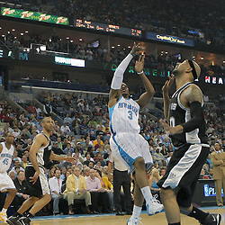 29 March 2009: New Orleans Hornets guard Chris Paul (3) shoots over San Antonio Spurs center Drew Gooden (90) during a 90-86 victory by the New Orleans Hornets over Southwestern Division rivals the San Antonio Spurs at the New Orleans Arena in New Orleans, Louisiana.