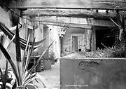 Can Masdeu, Barecelona, Spain 2004: derelict old bath house turned patio area with hammock swinging from broken roof beams