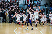Watertown rushes on to the court after their victory over Belmont in the  Division 2 North final at Woburn High School, March 12, 2016.  (Wicked Local Staff Photo/ Sam Goresh)