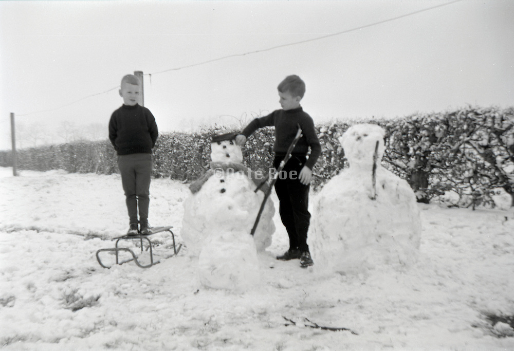 Two children with there snowmen