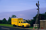 Pre privatisation British Telecom engineer up a telegraph pole with yellow 1975 Bedford J type van ....