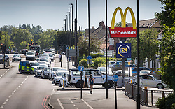 © Licensed to London News Pictures. 20/05/2020. Sutton, UK. Long queues build up at a McDonald's Drive Through restaurant at Sutton in south London. A small number of Drive Through only branches are opening today. The government has announced a series of measures to slowly ease lockdown, which was introduced to fight the spread of the COVID-19 strain of coronavirus. Photo credit: Peter Macdiarmid/LNP