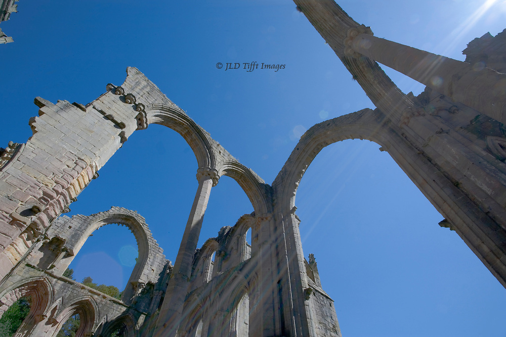 Yorkshire, Fountains Abbey ruins: looking up at the bare ruined choirs, empty arches.