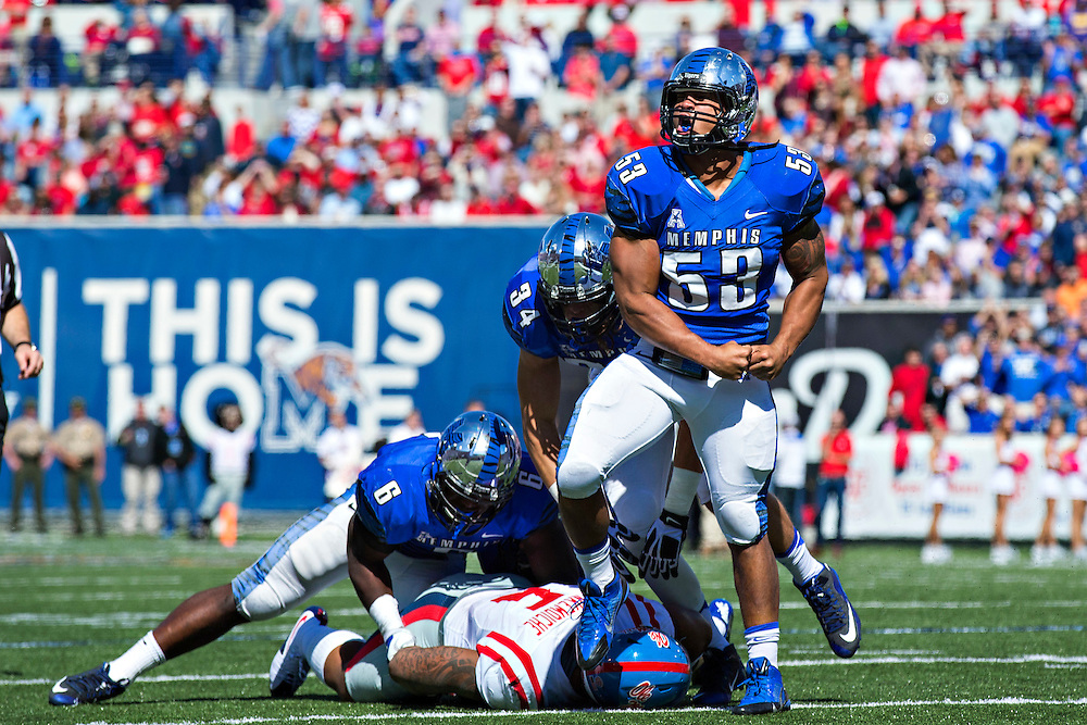 MEMPHIS, TN - OCTOBER 17:  Leonard Pegues #53 of the Memphis Tigers celebrates after making a tackle during a game against the Ole Miss Rebels at Liberty Bowl Memorial Stadium on October 17, 2015 in Memphis, Tennessee.  The Tigers defeated the Rebels 37-24.  (Photo by Wesley Hitt/Getty Images) *** Local Caption ***  Leonard Pegues
