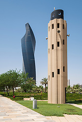 Skyscraper and Mosque Minaret at  Al Shaheed Park in Kuwait City, Kuwait