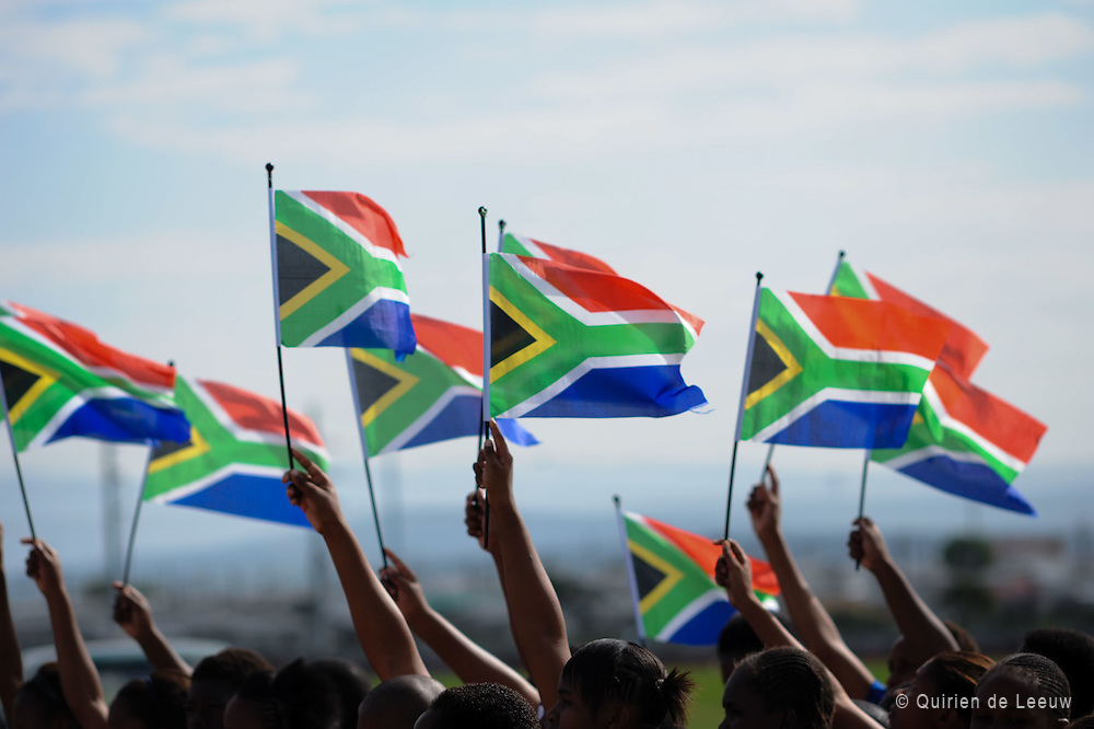 People celebrate Freedom Day in South Africa swinging with South African flags