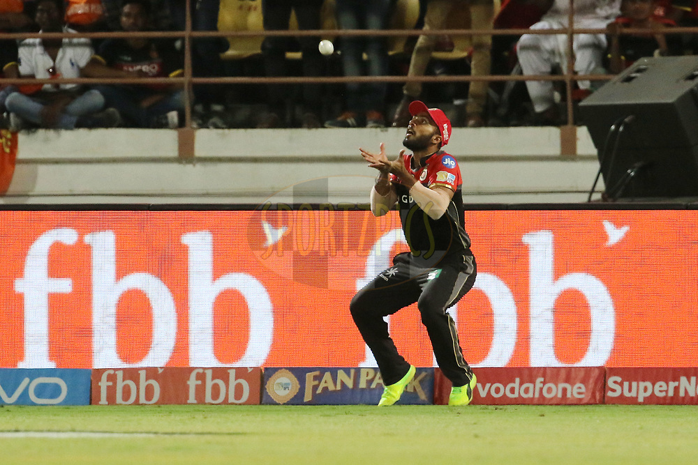 Mandeep Singh of the Royal Challengers Bangalore takes a catch of Dwayne Smith of the Gujarat Lions during match 20 of the Vivo 2017 Indian Premier League between the Gujarat Lions and the Royal Challengers Bangalore  held at the Saurashtra Cricket Association Stadium in Rajkot, India on the 18th April 2017<br /> <br /> Photo by Vipin Pawar - Sportzpics - IPL