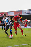 Rolando Aarons & Russell Penn during the Pre-Season Friendly match between York City and Newcastle United at Bootham Crescent, York, England on 29 July 2015. Photo by Simon Davies.