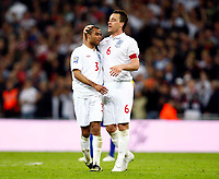 England's John Terry celebrates his  Goal with AshleyCole. World Cup Qualifer England v Ukraine at Wembley Stadium 01/04/2009. Credit  Colorsport / Kieran Galvin